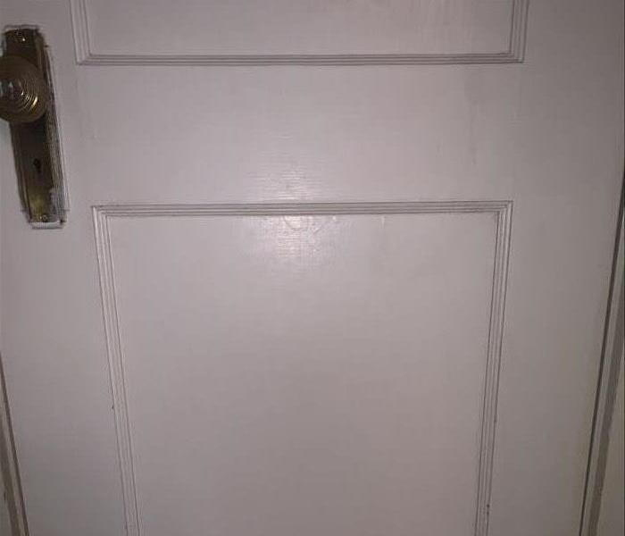 A clean white door with no spots