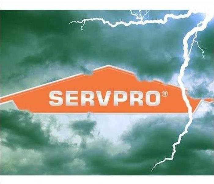 SERVPRO logo placed in the middle of a lightening storm sky